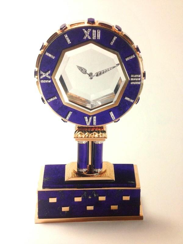 Reloj misterioso, lapislázuli, cristal de roca, diamantes talla sencilla, oro y platino.