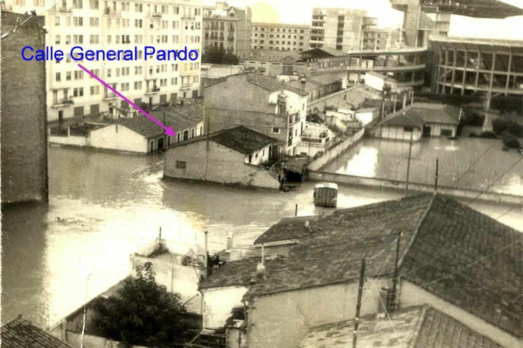 calle general pando en la riada de 1957