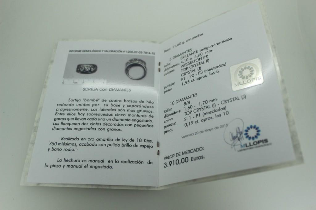 Informe gemológico de una joya con el nuevo sello holográfico del Laboratorio Gemológico MLLOPIS
