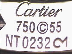 Punzones de una alianza con diamantes de la firma Cartier. Circa 1990 .