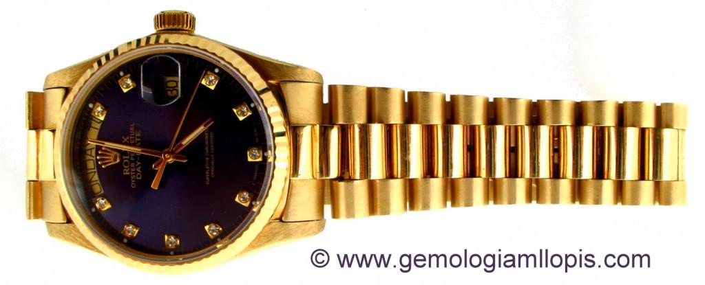 Reloj imitación a Rolex. Es de oro pero no es un Rolex, ni la máquina ni el brazalete.